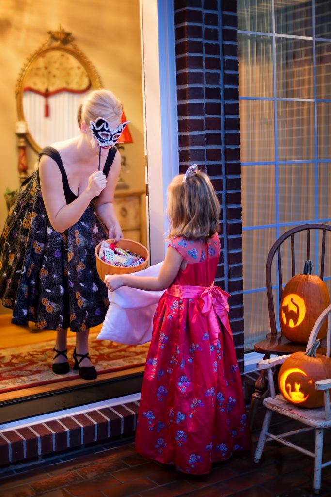 the children ask 'trick or treat'. This means that they have to give them sweets or they will suffer a horrible mischief.